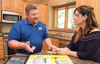 Mike, one of our Ceres plumbers, is talking with the customer regarding the homeowner agreement